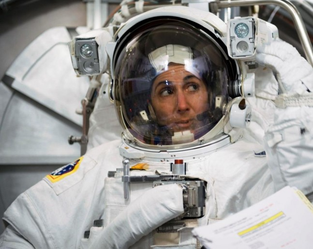 Astronaut_Nicole_Stott_participates_in_an_Extravehicular_Mobility_Unit_spacesuit_fit_check NASA photo posted on SpaceFlight Insider