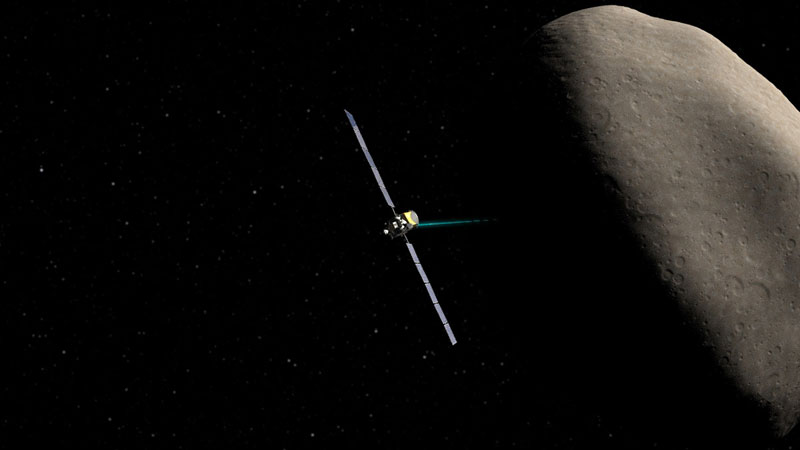 Artist concept showing the Dawn spacecraft at Ceres. Image Credit: NASA / JPL