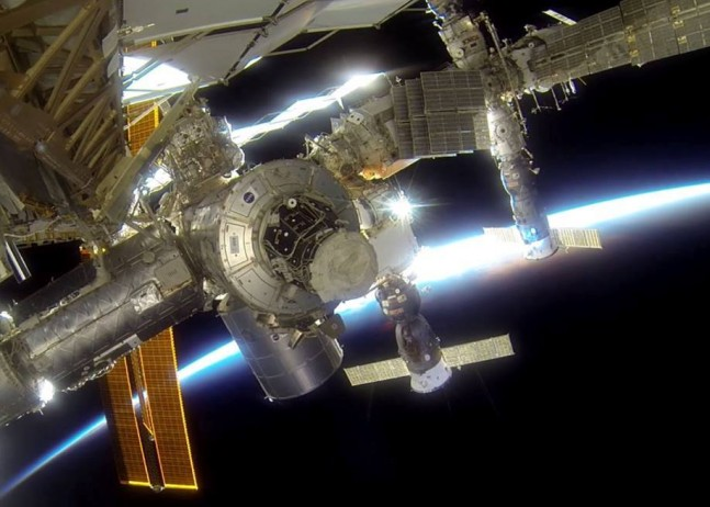 International Space Station on orbit Russian Soyuz Progress spacecraft NASA photo posted on SpaceFlight Insider