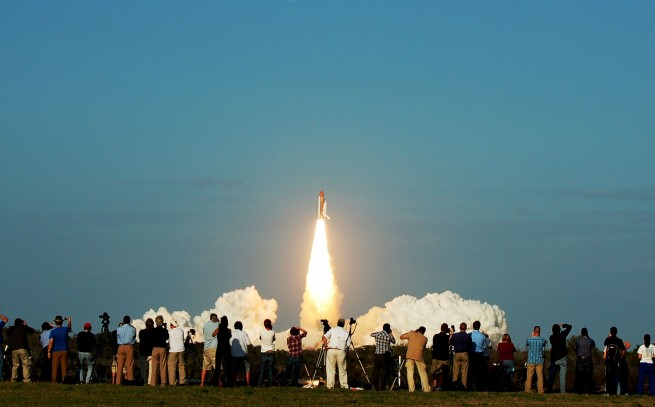 Launch of space shuttle Discovery on STS-133 photo credit Jason Rhian SpaceFlight Insider