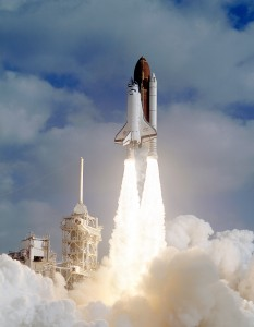 Space Shuttle Discovery launches on April 24, 1990 with the Hubble Space Telescope safely tucked into its cargo bay. Photo Credit: NASA