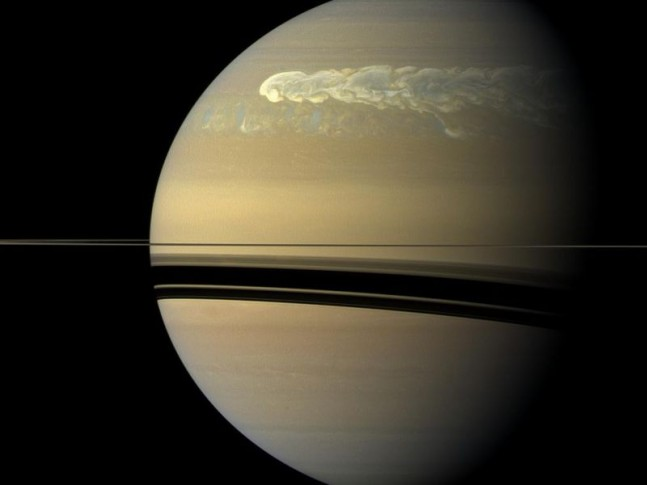 A huge storm can be seen in this NASA image churning through the atmosphere in Saturn's northern hemisphere overtakes itself as it encircles the planet in this true-color view from NASA's Cassini spacecraft. Image Credit: NASA/JPL-Caltech