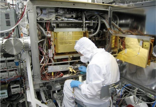 A Sample Analysis at Mars (SAM) team member at NASA Goddard prepares the SAM testbed for an experiment. Photo and Caption Credit: NASA posted on SpaceFlight Insider