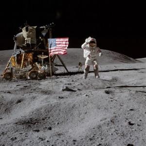 John Young leaps three feet as he salutes the flag. Photo Credit: NASA