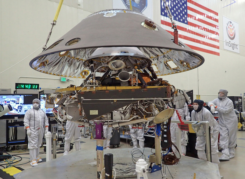 The back shell of NASA's InSight spacecraft is lowered onto the lander in a clean room at Lockheed Martin. Photo Credit: NASA/JPL-Caltech/Lockheed Martin