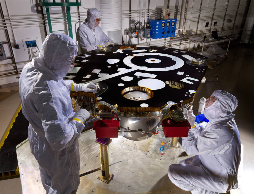 Technicians in a Lockheed Martin clean room near Denver prepare NASA's InSight Mars lander for propulsion proof and leak testing on Oct. 31, 2014. Following the test, the lander was moved to another clean room for start of the mission's assembly, test and launch operations (ATLO) phase. Photo and caption credit: NASA