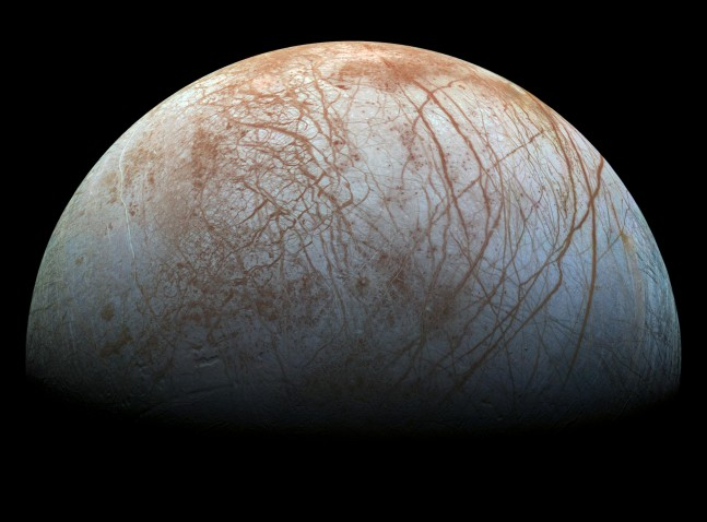 "Europa's intriguing surface is covered in mysterious brown ""scratches"" as seen on Spaceflight Insider"