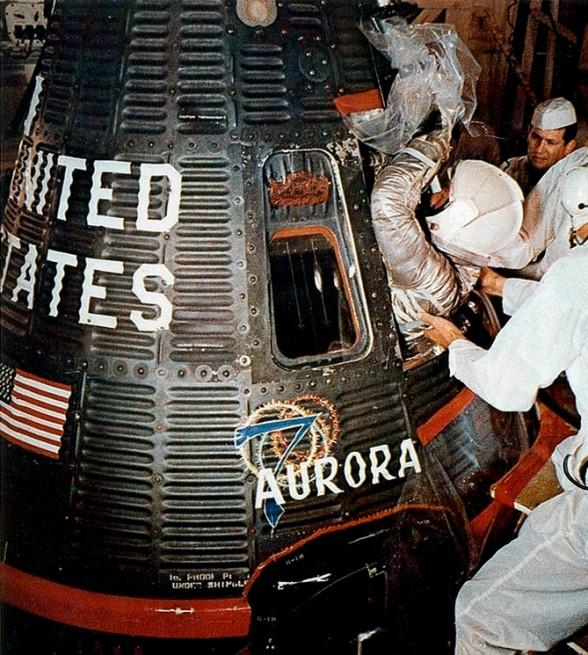 Scott Carpenter is helped into his Aurora 7 spacecraft for the Mercury Atlas 7 mission on May 24, 1962. Photo and Caption Credit: NASA
