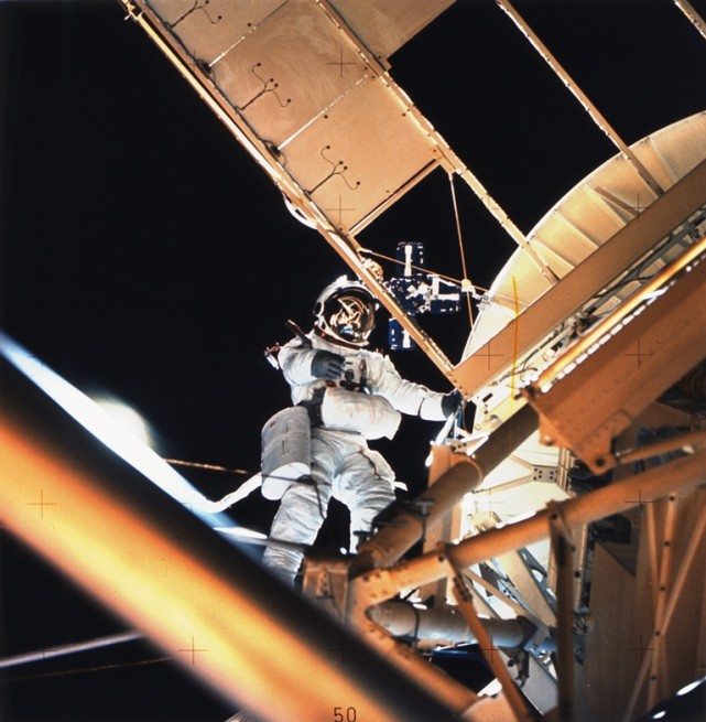 Skylab 3 crew conducting extra-vehicular activity EVA spacewalk NASA photo posted on SpaceFlight Insider