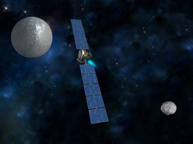 NASA's Dawn spacecraft transiting between asteroid Vesta and the dwarf Planet Ceres image credit NASA JPL