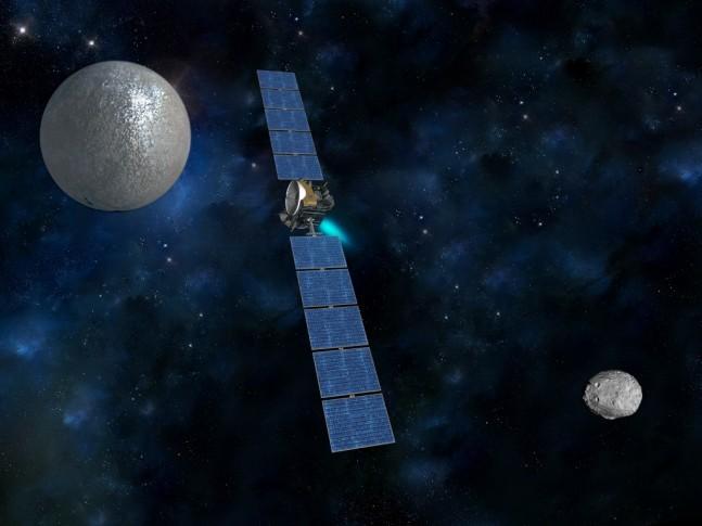 NASA's Dawn spacecraft transiting between asteroid Vesta and the dwarf Planet Ceres image credit NASA JPL