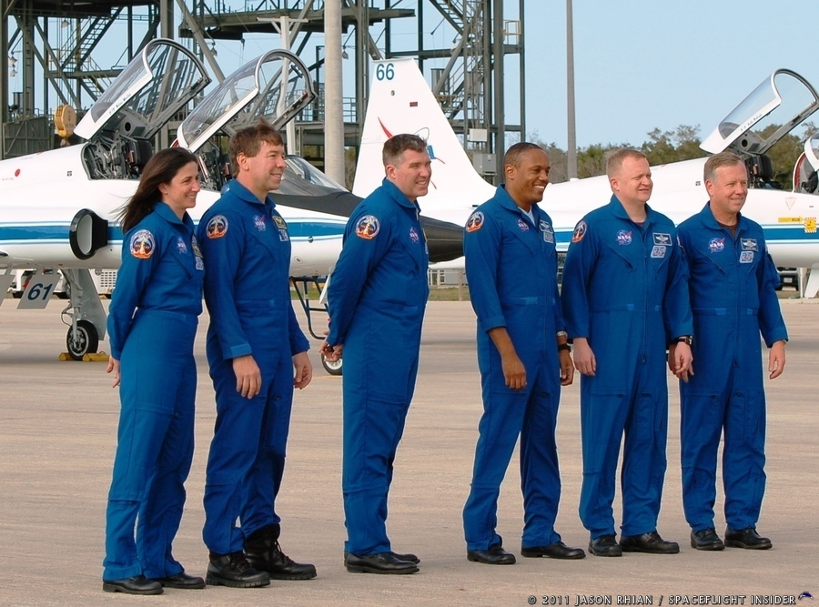 The crew of STS-133 pose for pictures at Kennedy Space Center's Shuttle Landing Facility  Commander Steve Lindsey, Pilot Eric Boe and Mission Specialists Alvin Drew, Steve Bowen, Michael Barratt and Nicole Stott photo credit Jason Rhian SpaceFlight Insider