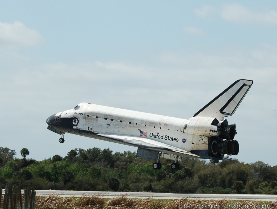 Space Shuttle Discovery touches down at the Shuttle Landing Facility after completing STS-133 in 2011. Photo Credit: Jason Rhian / SpaceFlight Insider
