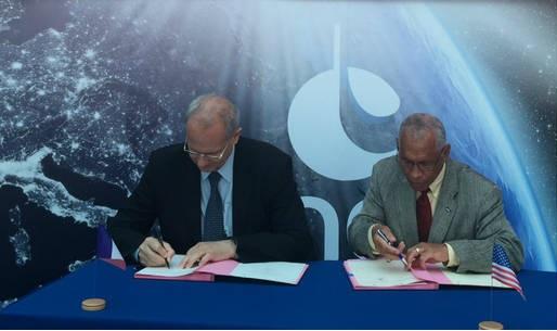 NASA Administrator Charlie Bolden signs international agreements with Jean-Yves Le Gall, Francisco Marín Pérez, and Ignacio Azqueta Ortiz. Photo Credit: NASA