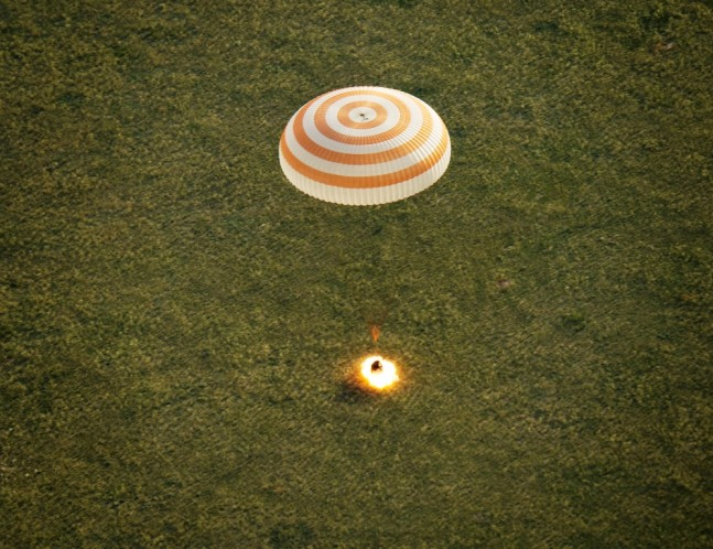 Expedition-43-crew-members-Terry-Virts-Samantha-Cristoforetti-Soyuz-TMA-15M-landing-Kazakhstan-photo-credit-Bill-Ingalls-NASA