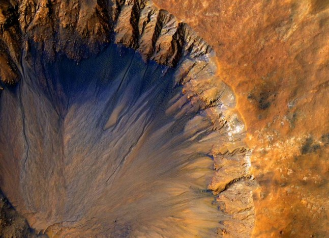 NASA Mars Reconnaissance Orbiter MRO image of crater on Red Planet NASA image posted on SpaceFlight Insider