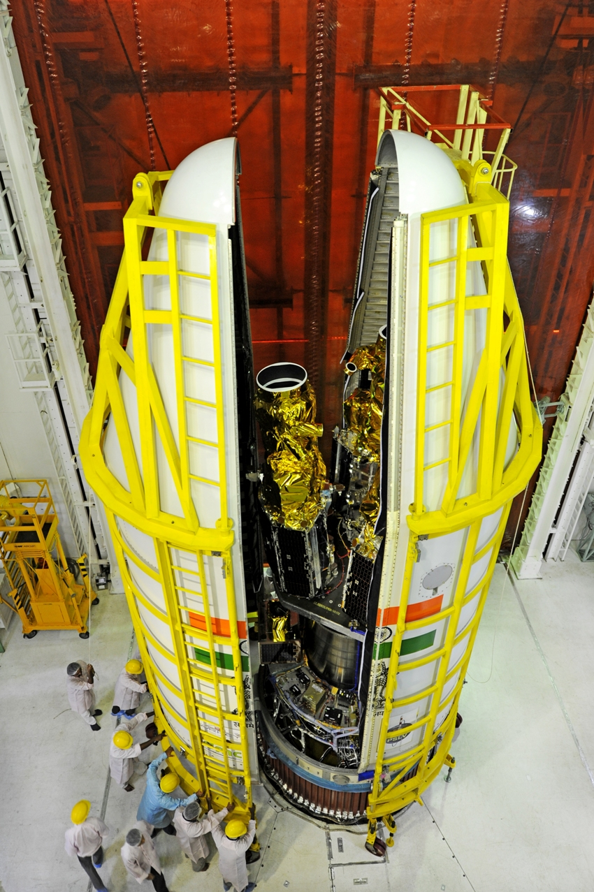 Five British satellites being encapsulated in the payload fairing for the PSLV-C28 mission