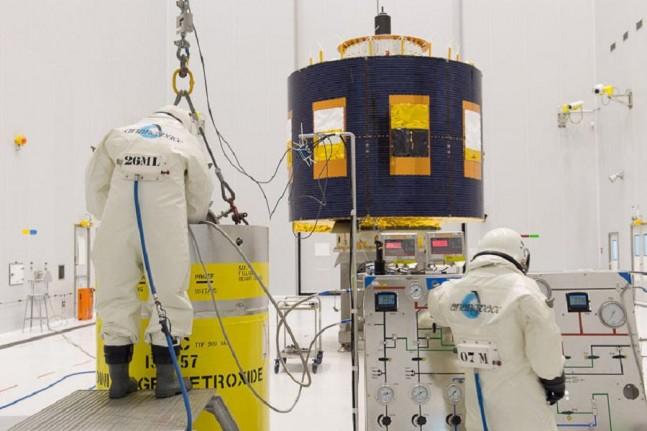 Engineers working on the MSG-4 satellite