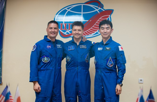Expedition 44 crew members pose for a photo at the conclusion of a press conference held at the Cosmonaut Hotel in Baikonur, Kazakhstan on Tuesday, July 21, 2015.