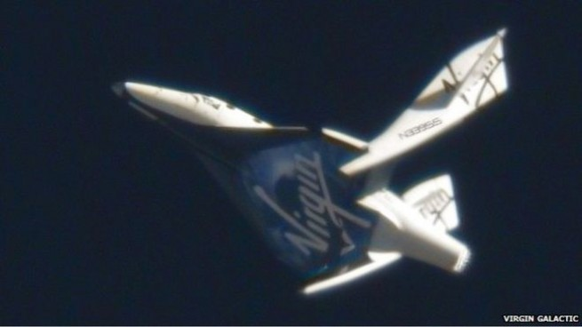 SpaceShipTwo with its tailbooms in the feathered position. Photo Credit: Virgin Galactic