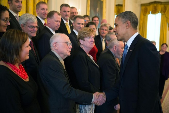 President Barack Obama congratulates William Borucki on being a finalist for the Samuel J. Heyman Service to America Medal in the East Room of the White House, Oct. 23, 2013