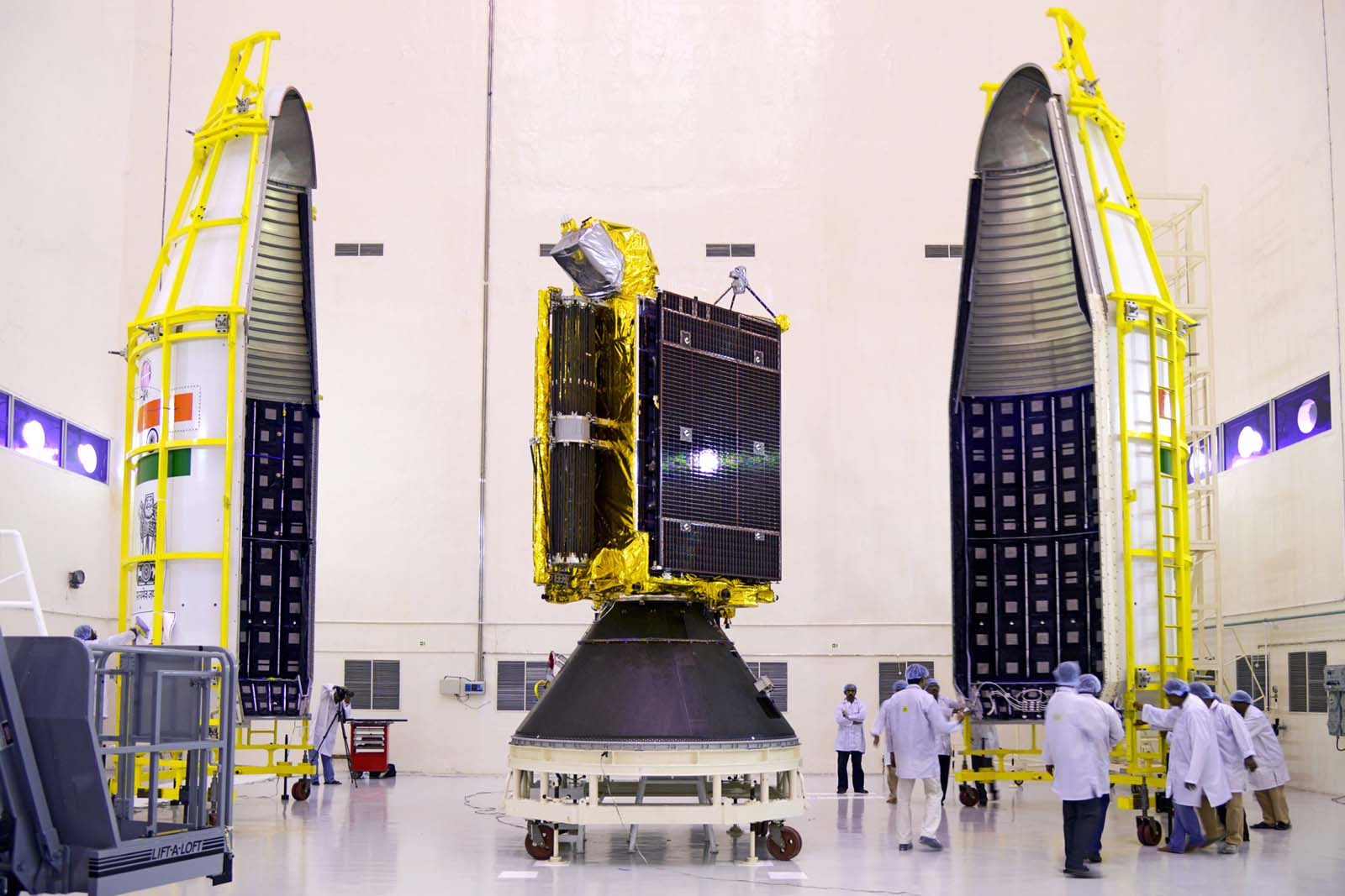 GSAT-6 seen with two halves of payload faring of the GSLV-D6.