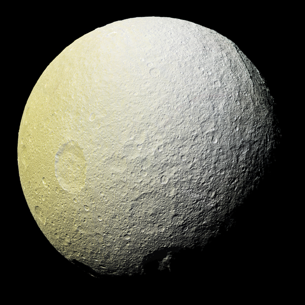 NASA Cassini space image of Saturn's moon Tethy's Image Credit NASA JPL Caltech posted on SpaceFlight Insider