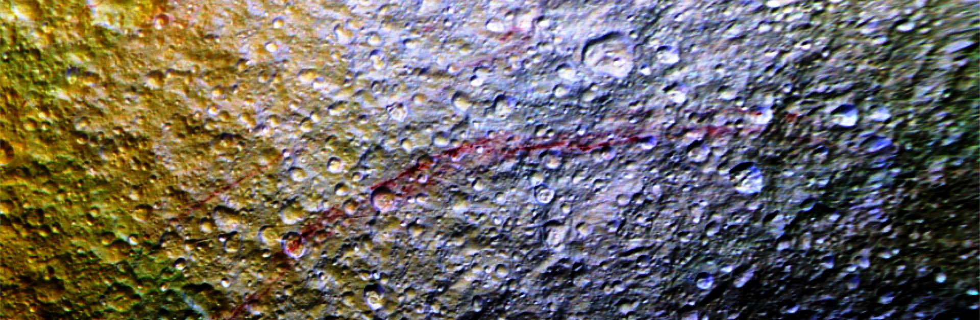 Red Streaks across the surface of Tethys NASA JPL Caltech Space Science Institute 2 photo posted on SpaceFlight Insider - Copy