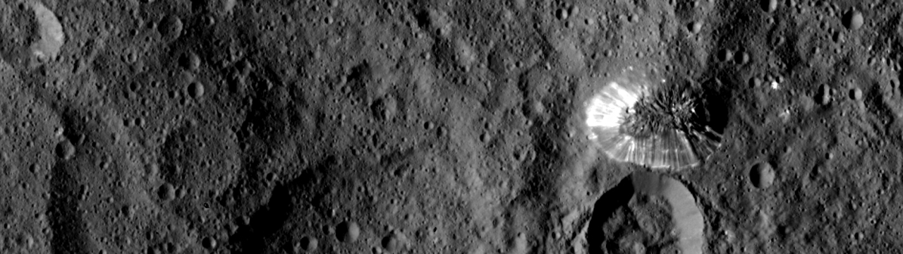 NASA's Dawn spacecraft spotted this tall, conical mountain on Ceres from a distance of 915 miles (1,470 kilometers). The mountain, located in the southern hemisphere, stands 4 miles (6 kilometers) high. Its perimeter is sharply defined, with almost no accumulated debris at the base of the brightly streaked slope. Image Credit: NASA / JPL-Caltech / UCLA / MPS / DLR / IDA