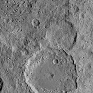 NASA's Dawn Spacecraft took this image of Gaue crater, the large crater on the bottom, on Ceres. Gaue is a Germanic goddess to whom offerings are made in harvesting rye. The center of this crater is sunken in. Its diameter is 84 kilometers (52 miles). The resolution of the image is 450 feet (140 meters) per pixel. Image Credit: NASA/JPL-Caltech/UCLA/MPS/DLR/IDA