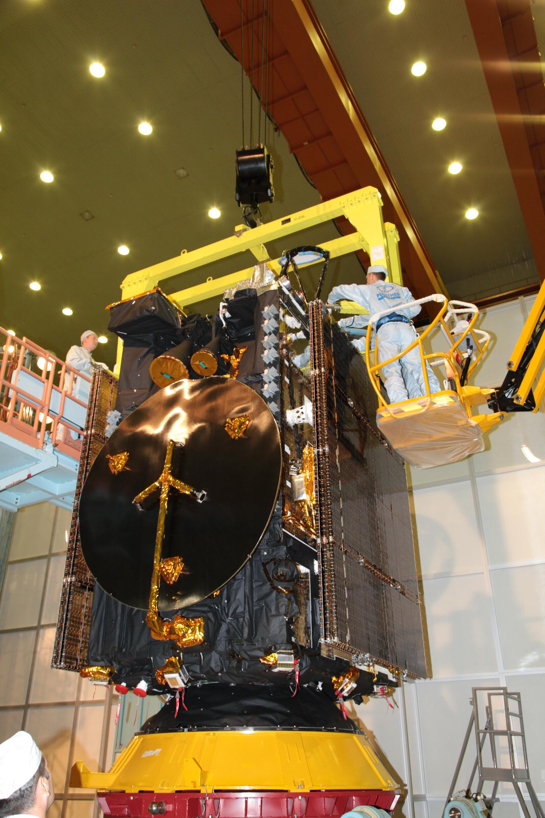 Engineers work on the Ekspress-AM8 satellite.