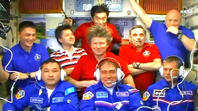 Andreas Mogensen, Aidyn Aimbetov, Andrey Volkov, Oleg Kononenko, Gennady Padalka, Kimiya Yui, Kjell Lindgren, Mikhail Korniyenko and Scott Kelly. Image Credit: NASA TV