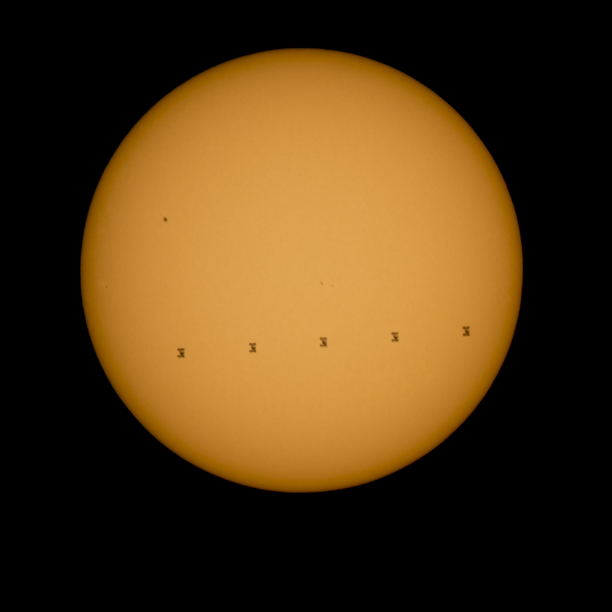 A 5-frame composite image showing the ISS transiting the Sun on 2015-09-06
