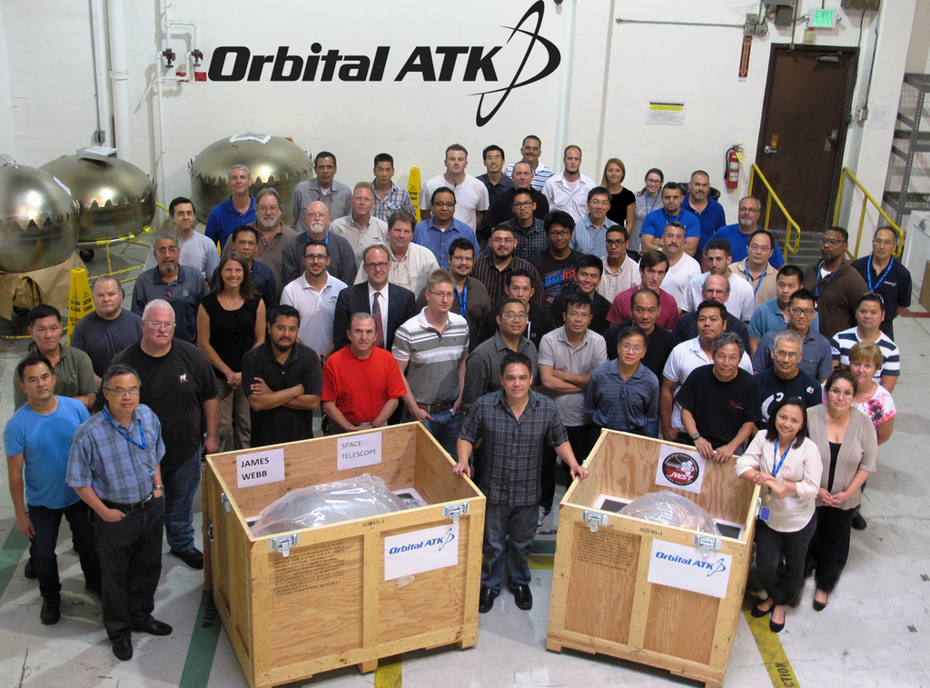 Orbital ATK employees pose with fuel and oxidizer tanks for NASA's James Webb space Telescope. Photo Credit: Orbital ATK
