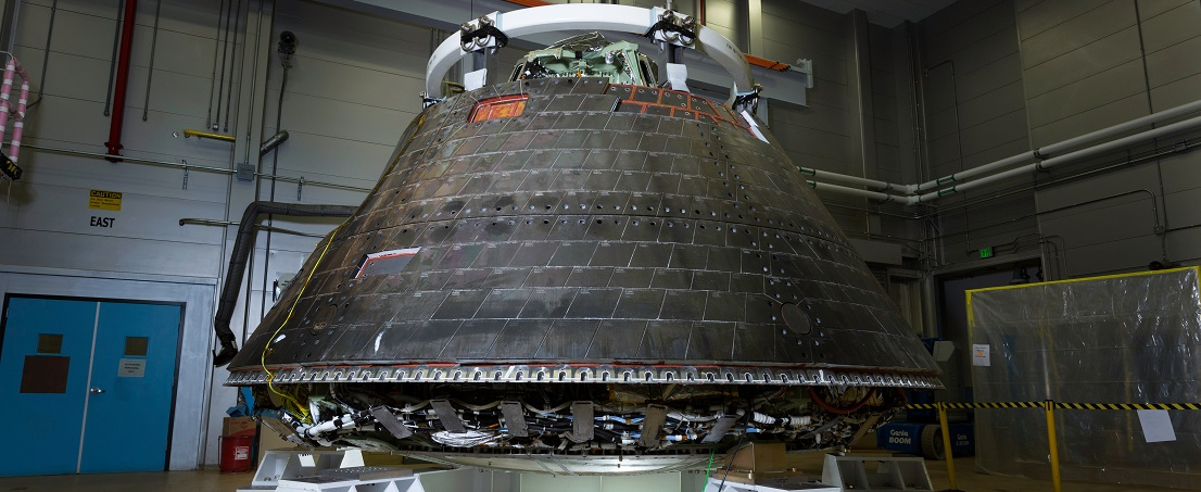 The Orion crew module is placed in a secure stand where it will undergo decontamination