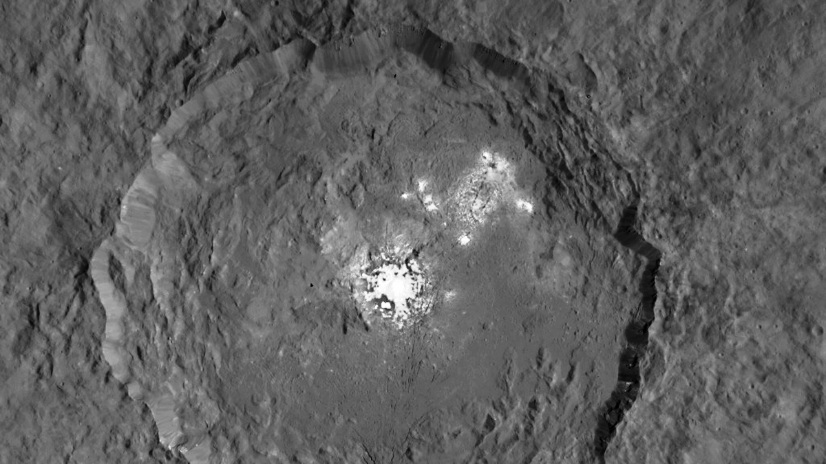 This image, made using images taken by NASA's Dawn spacecraft, shows Occator crater on Ceres, home to a collection of intriguing bright spots. Image Credit: NASA / JPL-Caltech / UCLA / MPS / DLR / IDA