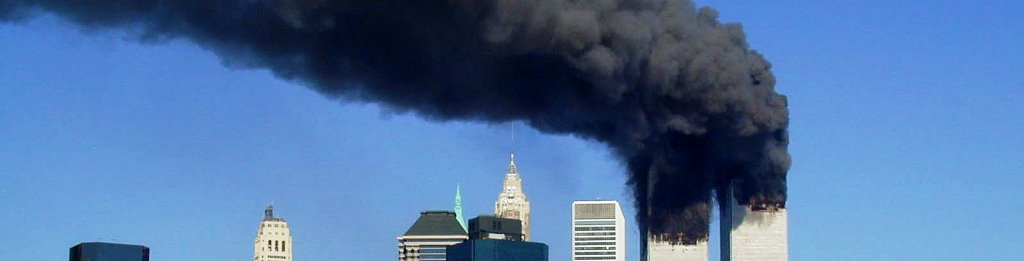 The World Trade Center in flames after Islamic terrorists slammed planes into the north and south towers photo credit Michael Foran