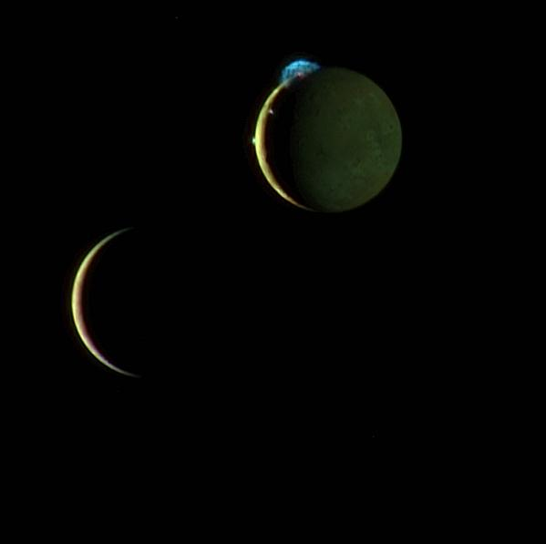 This is a composite image of Io and Europa taken March 2, 2007 with the New Horizons spacecraft. Here Io is at the top with three volcanic plumes visible. The 300-kilometer (190-mile) high plume from the Tvashtar volcano is at the 11 o'clock position on Io's disk, with a smaller plume from the volcano Prometheus at the 9 o'clock position on the edge of Io's disk, and the volcano Amirani between them along the line dividing day and night. Photo Credit: NASA / JHU Applied Physics Laboratory / Southwest Research Institute