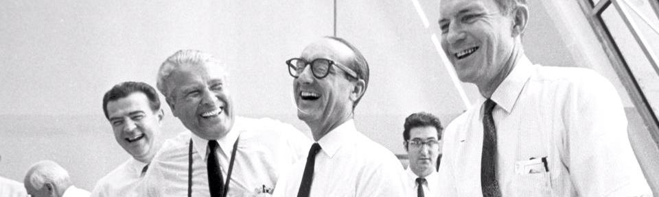 Dr. George E. Mueller (center with glasses) shares a laugh with Wernher von Braun and other NASA officials during the Apollo era. NASA photo posted on SpaceFlight Insider