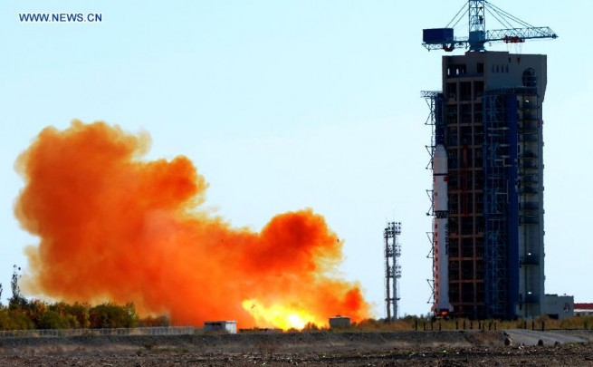 A Long March 2D carrier rocket carrying the Jilin-1 satellites blasts off from the launch pad at the Jiuquan Satellite Launch Center in northwest China's Gansu Province, Oct. 7, 2015