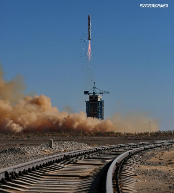 A Long March 2D carrier rocket carrying the Tianhui-1C mapping satellite blasts off from the launch pad at the Jiuquan Satellite Launch Center in northwest China's Gansu Province, Oct. 26, 2015.