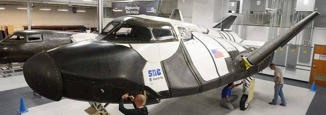 SNC technicians inspect the Dream Chaser ETA.