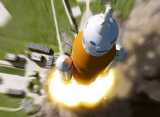 Space Launch System rocket blasts off of Launch Complex 39B with Orion spacecraft on Exploration Mission 1. NASA image posted on SpaceFlight Insider