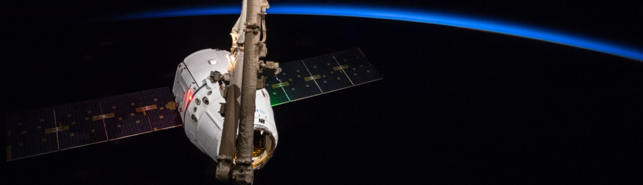 SpaceX Dragon spacecraft being berthed to the International Space Station NASA photo posted on SpaceFlight Insider