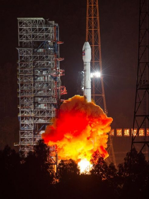 A Long March 3B rocket carrying the LaoSat-1 satellite blasts off from the Xichang Satellite Launch Center in Xichang, southwest China's Sichuan Province, Nov. 20, 2015.