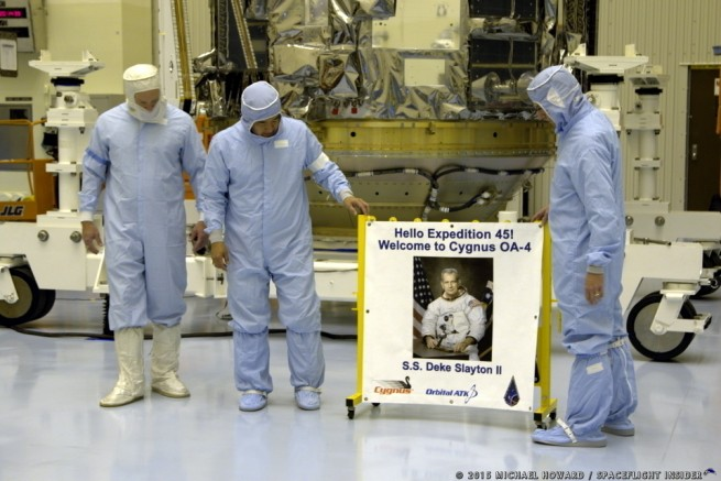 From left-to-right United Launch Alliance's Kevin Leslie, Orbital ATK's Dan Tani and NASA's Randy Gordon around an image of former Apollo astronaut Deke Slayton. Photo Credit: Michael Howard / SpaceFlight Insider