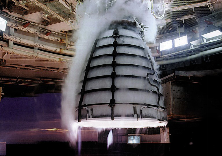 An RS-25 being tested at NASA's John C. Stennis Space Center. Photo Credit: NASA / Aerojet Rocketdyne RS-25 rocket engine test firing at Stennis Space Center in Mississippi NASA photo posted on SpaceFlight Insider