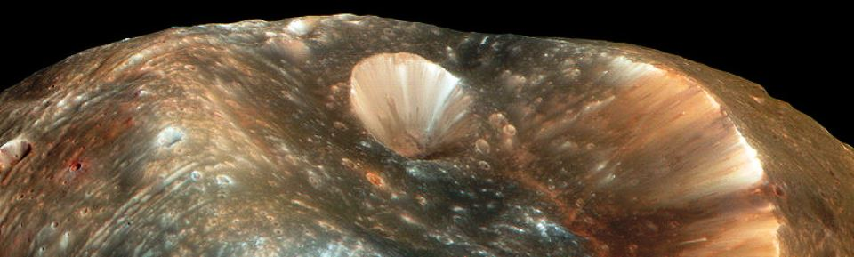 Stickney crater on the Martian moon Phobos taken from the Mars Reconnaissance Orbiter or MRO and posted on SpaceFlight Insider