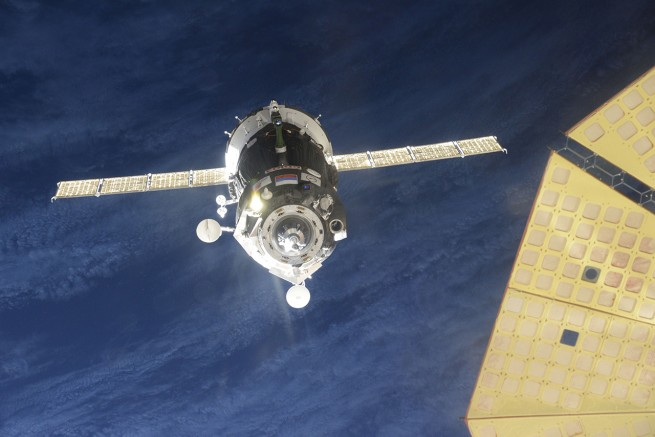 Just moments before docking, the spacecrafts automatic docking system, KURS, failed. The Soyuz then automatically backed away. Yuri Malenchenko then took manual control to dock the spacecraft about 25 minutes later. Photo Credit: NASA TV