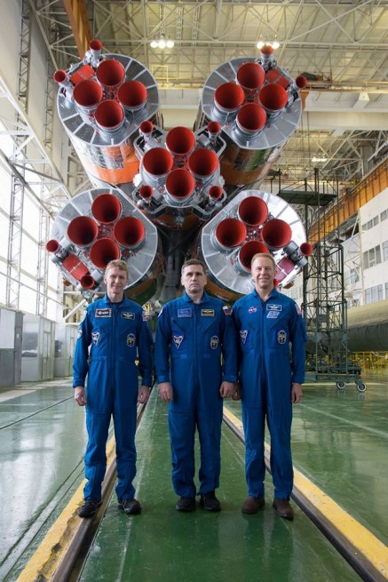 Crew of Expedition 46 pose for photo with Soyuz rocket at the Baikonur Cosmodrone NASA photo posted on SpaceFlight Insider
